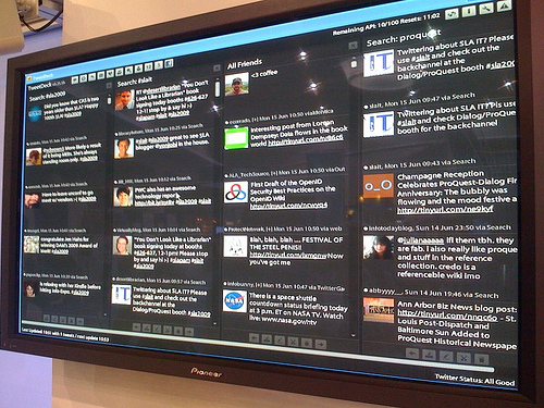 Info-Expo Twitter screen at Dialog/ProQuest booth. The backchanne live